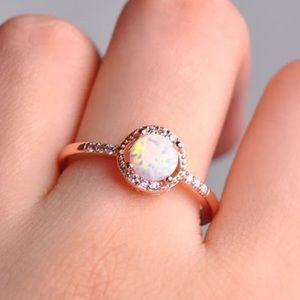 Rose gold round cut white fire opal ring